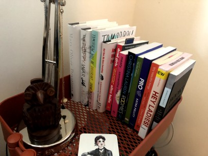 12 books on the top of a bedside cart